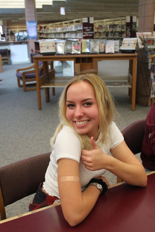 Andrea Burkhart (12) showing off her flu shot.