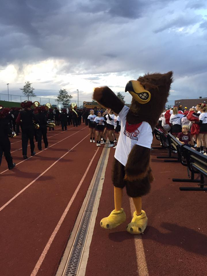 Huey the Hawk showing off their school spirit at the USA themed football game.