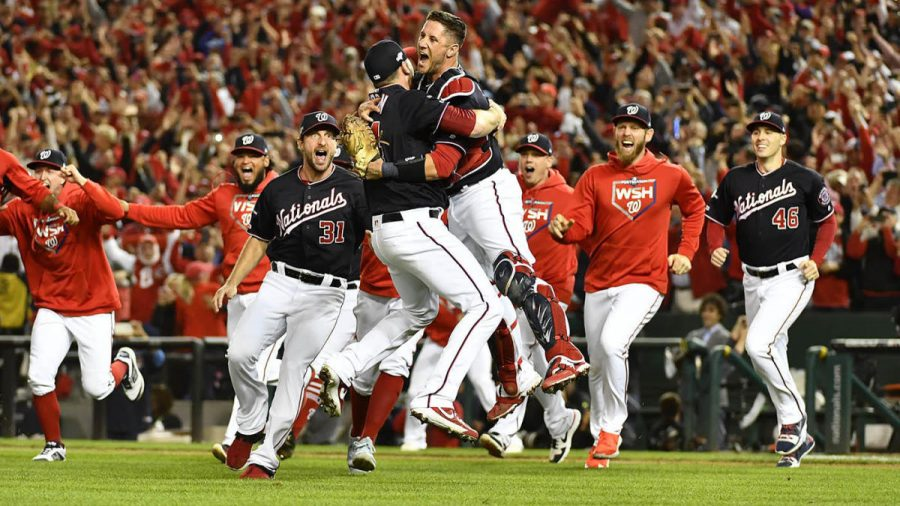 Oct 15, 2019; Washington, DC, USA; Washington Nationals catcher Yan Gomes (10) hugs relief pitcher Daniel Hudson (44) as they celebrate their win over the St. Louis Cardinals in game four of the 2019 NLCS playoff baseball series at Nationals Park. Mandatory Credit: Brad Mills-USA TODAY Sports